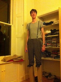 7ft tall guy dresses as a normal guy on stilts for Halloween. TOO GOOD