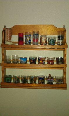 Vintage spice rack used for shot glass holder.