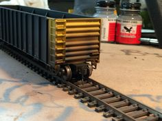 Weathered high side thrall  gondola using an air brush..