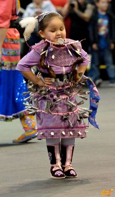 jammin! Sweet little Native American girl dancing in her jingle dress.