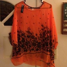 Sheer dressy top Sheer orange with black flowers dolman sleeve top. Flowy and beautiful! New never worn. Tops