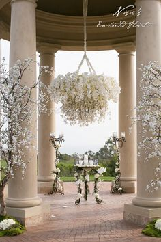 Nisie's Enchanted Florist -- Pelican Hill's grand Palladian-inspired rotunda is such a dreamscape for an enchanting wedding ceremony. Phalaenopsis orchids, hydrangeas, cherry blossoms, nisiesenchanted, floral chandeliers, wedding ceremony, wedding florals, pelican hill, rotunda
