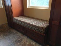 Tribal pattern, custom bench cushion in a mud room. Crafted in Sunbrella Chimayo Partridge