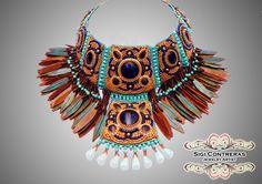 Amosis by Sigi Contreras. Polymer Clay Cabs and feathers made by the artist, Japanese seed beads, Swarovski crystal and Turquoise.