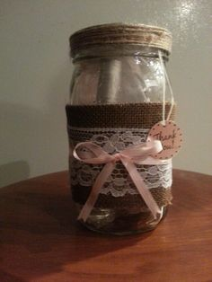 Prizes for winning a game at a Classic Pooh/Rustic themed Baby Shower.  I used wide mouth mason jar to fill with girly stuff (spray, lotion) but they can really be filled with anything.  First wrapped in burlap, then a lace ribbon followed by a thin pink ribbon.  Finished off with a thank you tag.