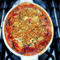 Jamie Oliver's Eggplant Parmesan Recipe Main Dishes with eggplant, olive oil, onions, garlic, dried oregano, plum tomatoes, red wine vinegar, fresh basil leaves, ground black pepper, salt, parmigiano reggiano cheese, dry bread crumbs, fresh oregano leaves