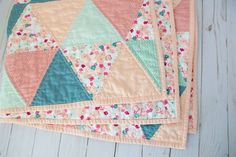 Modern Triangle Baby Quilt  Handmade Baby Quilt  Triangle Baby Quilt  Modern Baby Quilt  Baby Shower Gift Handmade Baby Quilts, Art Gallery Fabrics, Diy Sewing Projects, Coordinating Fabrics, Quilt Modern, Machine Quilting, Quilt Baby, Baby Shower Gifts, Printing On Fabric