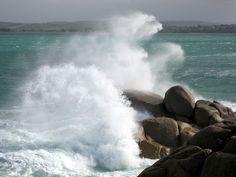 waves crash against the rocks of Granite Island
