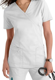 A great selection of Cherokee scrubs. Core Stretches, White Scrubs, Scrubs Uniform, Cherokee Scrubs, Fashion Vocabulary, Uniform Design, Medical Scrubs, Nursing Dress, Scrub Tops