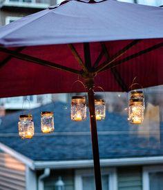 mason jar lanterns for the backyard... great idea to suspend under a patio umbrella!