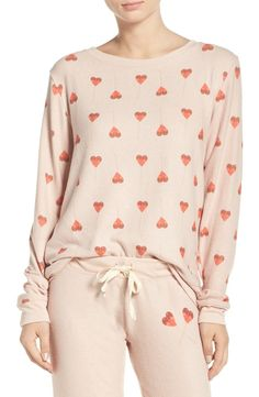 Sugary-sweet heart lollipops playfully pattern this soft and cozy pullover that's ready for lounging or sleeping.