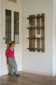 Pallets naturally make good shelves - and if the little area isn't big enough it is super easy to attach larger shelves.