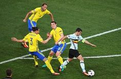 Eden Hazard attempts to bamboozle Erik Johansson and Kim Kallstrom with some nifty footwork.
