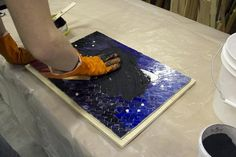 Rub grout into the mosaic.