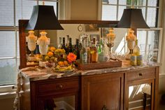 Nell Hill's blog - beautiful sideboard used as a drink station on a sun porch.