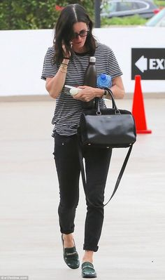 Calm and collected: Courtney Cox, 51, was spotted keeping it casual in light of her second chance as she stepped out in Hollywood on Thursday, deep in conversation on her phone