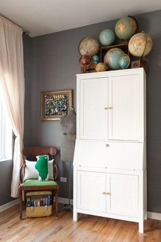 This globe collector got it right by storing her collection on top of an armoire. Globes take up a lot of real estate, and this dense display sits out of the way and keeps lower surfaces clear for use. Love the frame around the Thread holder