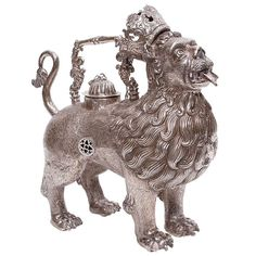 19th Century Lion Aquamanile from Peru | From a unique collection of antique and modern decorative objects at https://www.1stdibs.com/furniture/more-furniture-collectibles/decorative-objects/