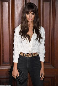Lithe: Ratajkowski, 26, showed off her trim figure in a white fringed blouse with blue skinny jeans cinched with a leopard print belt