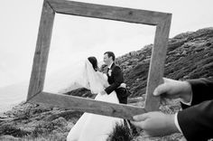 The happy couple framed by our rustic vintage frame.  www.capeoflove.com