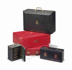 A COLLECTION OF LEATHER DISPATCH AND OTHER BOXES Comprising two red boxes inscribed 'CHANCELLOR OF THE DUCHY OF LANCASTER' with Queen Elizabeth cyphers numbered 2 & 8, a black box inscribed 'PARLIAMENTARY UNDER SECRETARY OF STATE. DEPARTMENT OF EDUCATION AND SCIENCE', a smaller George V black leather box for the Chancellor of the Duchy of Lancaster, and a leather writing case with pull-out drawers