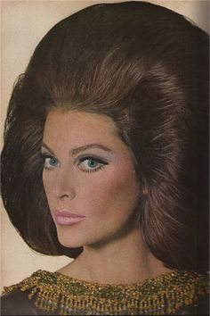Oh my! I bet that hair will NOT move in the wind!  CLAIROL'S BRUNET BEAUTY IRVING PENN VOGUE SEPTEMBER 1966