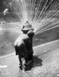 New York children cooling off under the spray of a fire hydrant during a heat wave, 1945 - Peter Keegan/Keystone/Getty Images