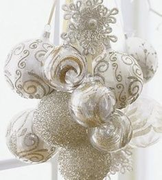 51 Exquisite Totally White Vintage Christmas Ideas   DigsDigs!!! Bebe'!!! A lovely bouquet of white formal ornaments suspended on ribbons for lovely window or light fixture displays in a foyer or formal dining room chandelier!!! Bebe'!!! Add a lace and pearl accent and you have a beautiful unique ornament display!!!   best stuff