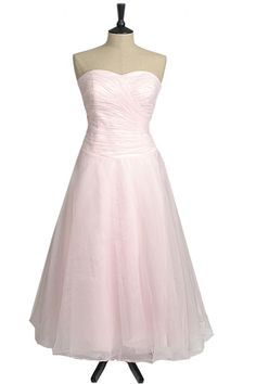Organza wrapped bodice with a full layered skirt. Perfect prom, evening, bridesmaid dress
