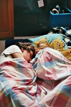 Sleeping couple .. I love the Disney sheets ...
