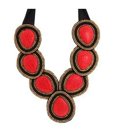Maximina - Red -  This hand embroidered bib style statement necklace has seven large red magnesite stones surrounded by gold and black seed beads. Enforced with black felt backing. Black ribbon makes this piece adjustable in length. http://www.cayetanolegacy.com