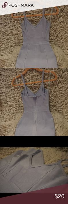 Scrappy Side Splitting Bandage Dress V neck strappy side splitting bandage dress in Ice Blue (greyish blue color) in size S. Very flattering & form-fiting. This dress was only worn once. Originally purchased for $50 Dresses Midi
