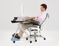Envelop - Desk - Herman Miller - this is an awesome desk, has wheels and the front part slides down and can adjust to different people