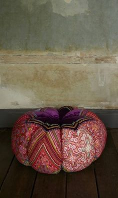 Beautiful reversible pumpkin shaped pouf made from pieces of tribal and velvet fabrics with ric rac and ribbon trim.