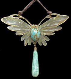 ELIZABETH BONTE  Art Nouveau Butterfly Pendant    Engraved horn, heightened with colour Signed: 'E. Bonte' verso