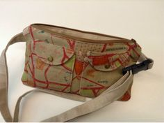 Outer pockets with metal snaps.  Beatnik Waist Bag - ayliN-Nilya