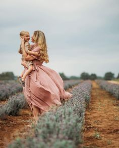 Beautiful photo of mother and child. Lavender field.