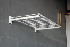 """Strong Racks Steel Wall Shelf (4 Shelves) - 250 Pound Capacity 18""""x36"""" by Strong Racks. $69.00. 18 inches deep by 36 inches in length. 250 Pound Capacity - 4 Shelves. Includes mounting brackets, grids and hardware for wood stud installation. Additional bike accessory available for purchase. Powder Coated White. This amazingly strong steel wall shelf is capable of holding 250LBS. This is perfect for any garage or laundry room setting. The system comes with 4"""" lag..."""