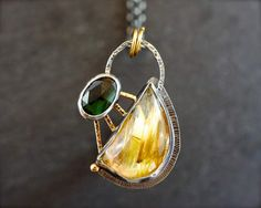 Star rutilated quartz & green tourmaline pendant in mixed metal. Sterling silver and 18K gold rutilated quartz pendant. Rose cut tourmaline.