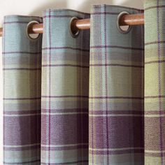 Finished with warm plum and jade green tones, this pair of Orkney curtains are designed with a traditional check, complete with a modern eyelet header and full lining, available in a choice of sizes.
