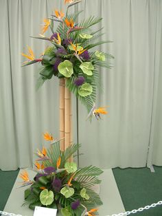 ~ Pin on Crystal's Pink, Orange, Green Bamboo wedding ~ I like the tiered heights here. too bad it's kinda. :x Bird of Paradise, Bamboo and Anthurium tropical arrangement Tropical Flowers, Tropical Floral Arrangements, Artificial Floral Arrangements, Unique Flower Arrangements, Unique Flowers, Exotic Flowers, Flower Centerpieces, Flower Decorations, Beautiful Flowers
