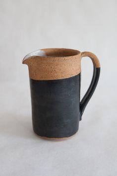 Cassie Griffin's amazing ceramics #ceramics #pottery #cassiegriffin #pitcher #vase #faces #blue #stripes