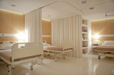 Soft and smooth materials such as fabrics and wood surfaces, as well as the minimization of visual noise from hospital equipment, are intended to be helpful to the psychological state of patients. Modern Hospital, New Hospital, Hospital Room, Clinic Interior Design, Clinic Design, Medical Office Design, Healthcare Design, Hospital Curtains, Hospital Design