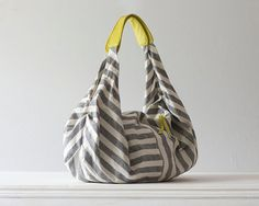 bags...i LOVE bags. and am into the new fad of yellow + gray. AND it's stripes. can't get much better than this...