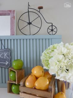 early fall harvest mantel with apples pears in a crate hydrangeas faux chalkboard bicycle at thehappyhousie