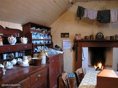 This is the museum at Garenin on the Isle of Lewis, Scotland. The homes, called blackhouses, were originally designed to house people and livestock together with a partition between them. You can see more beautiful kitchens at www.naturalhomes.org/natural-kitchens.htm