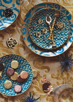 Peacok Blue and gold plates are amazing color and pattern which embodies the bohemian estectic