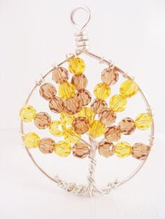 Golden Autumn Tree of Life Pendant Necklace. $45.00, via Etsy.