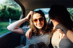 Happy women travel by car stock photo