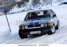 PAS DE LA CASA, ANDORRA - DEC 19 : Spanish driver Jose Manuel Lopez and his codriver Josue Sanchez in a  race in the Andorra Winter Rally 2015, on Dec 19, 2015 in Pas de la Casa, Andorra.